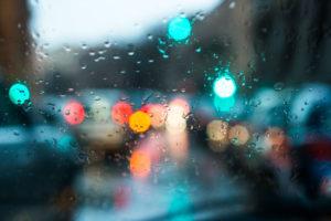blurred light through a wet windshield